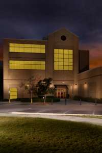 A night photo of the college's Veterinary Academic Building. (Photo by David Johnston)