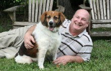Steve  Roberts with his dog, Tucker.