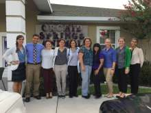 Veterinary students are shown outside of a practice during a business management clerkship.