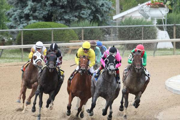 Horses are shown racing at Churchill Downs.