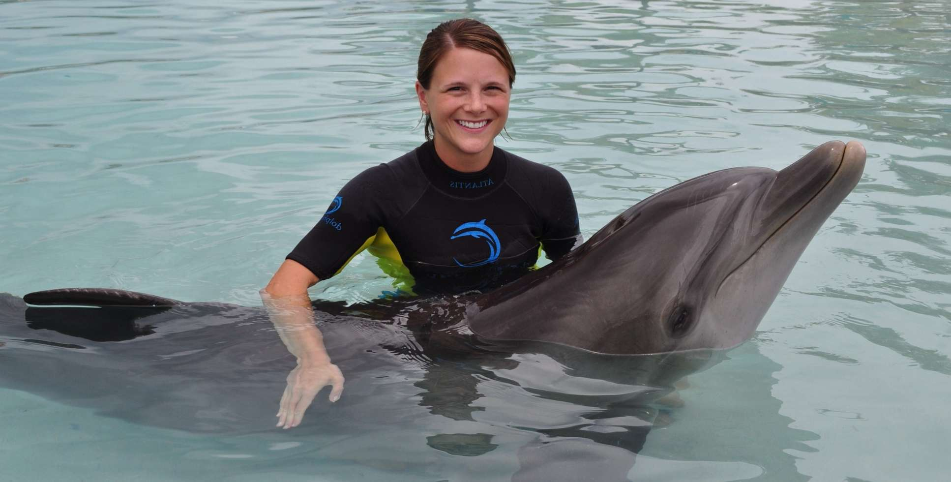 Veterinarian with dolphin