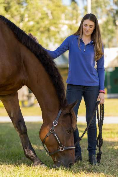 Danielle Ammeson and her horse, Casino Royale, relax between photos outside UF's Large Animal Hospital on Oct. 14. (Photo by Louis Brems)